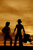 pic of nativity  - a silhouette of a Native American woman standing by her male cowboy - JPG