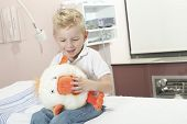 foto of pediatric  - A Boy Relaxing in pediatric hospital with plush - JPG