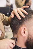 picture of clippers  - Close-up of hairdresser cutting hair of a male with hair clipper on back of the head in hairdressing salon.