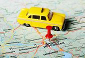 foto of dnepropetrovsk  - Close up of Dnepropetrovsk Ukraine map with red pin and a taxi toy - JPG