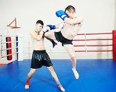 foto of boxing ring  - combat sport muai thai sportsman fighting at training boxing ring - JPG