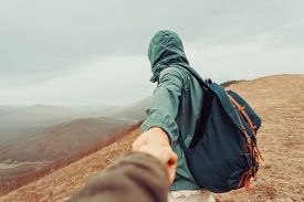 image of pov  - Traveler man holding woman - JPG