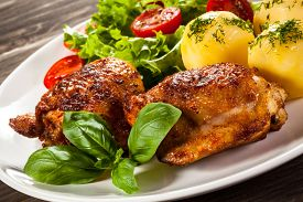 picture of boil  - Barbecued chicken legs with boiled potatoes and vegetables - JPG