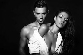 pic of studio  - black and white fashion photo of sexy impassioned couple posing in studio - JPG
