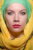 foto of burka  - Serious woman wearing colourful headscarf - JPG