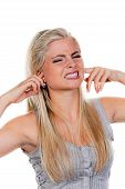 foto of noise pollution  - Young woman suffering from noise pollution and holding her ears - JPG