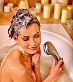 pic of bubble bath  - Young woman with wet head take bubble  bath - JPG