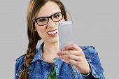 pic of ugly  - Beautiful woman taking a selfie and making a ugly face - JPG