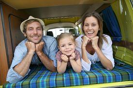 image of camper  - Portrait of cheerful family having fun in camper - JPG