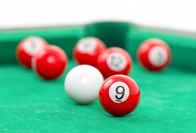 foto of snooker  - Snooker balls on a green snooker table - JPG