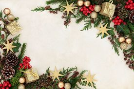 picture of greenery  - Christmas background border with gold bauble decorations - JPG