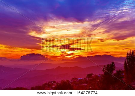 poster of Amazing mountain landscape with colorful vivid sunset on the bright sky, natural outdoor travel background