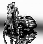 Young beautiful couple under car