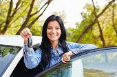 Happy Woman Driver Showing Car Keys And Leaning On Car Door poster