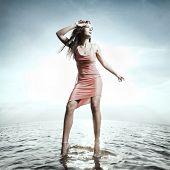 Beautiful girl standing on water