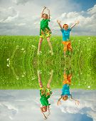 Pretty child having fun in the field. Specular reflection in the water.