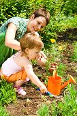 Little gardener helping mom