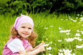image of flower girl  - Happy kid on the meadow with white flowers - JPG