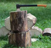Chopping wood - ax in a log outdoors