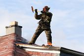 Firefighter fighting a fire from the rooftop