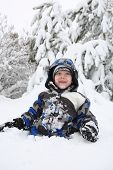 image of frostbite  - Child playing in the snow with snow on his face - JPG