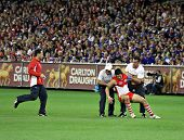 MELBOURNE - SEPTEMBER 12: Sydney swans player is helped to his feet in the AFL second semi final - Western Bulldogs vs Sydney Swans, September 2008