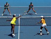 MELBOURNE, AUSTRALIA - JANUARY 24: Doubles match Serena & Venus (Front L) Williams vs Andrea Hlavack