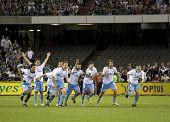 MELBOURNE - 20 de março: Sydney FC jogadores comemoram sua vitória final grand da-League Vict Melbourne