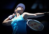 MELBOURNE, AUSTRALIA - JANUARY 26: Jie Zheng in action at her quarter final win over Maria Kirilenko