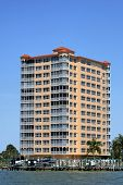 stock photo of high-rise  - fancy building on the waterfront in south west florida against a deep blue sky