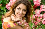 stock photo of beautiful face  - beautiful woman in garden with roses - JPG