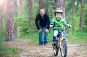 Little Kid Boy Of 3 Years And His Father In Autumn Forest With A Bicycle. Dad Teaching  Son. Man Hap poster