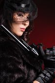 stock photo of girls guns  - elegant lady with a pistol in hands - JPG