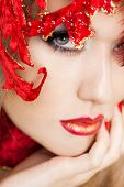 beautiful fashionable woman with art leaves on head