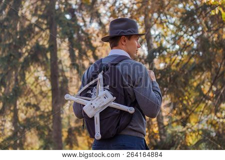 poster of The Uav Drone And Photographer. Drone Copter Flying With Digital Camera. Men Is Travelling With Back