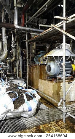 poster of Electric Motor On Baseplate In Pulp Industial , Motor Under Scaffolding Platforms