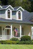 Relaxing Home with American flag on porch 02