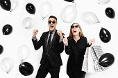 Beautiful Stylish Couple, Young Girl In A Black Dress And A Man In A Black Suit, Holding Balloons An poster