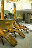 Spa resort wood lounge chairs in relaxing  environment