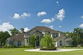 Upscale large home with big blue sky