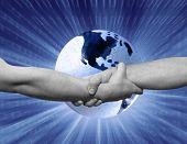 handshake&glowing puzzle earth globe