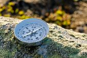 Reliable Compass On The Stone In Tundra. Concept For Travelling And Active Lifestyle poster