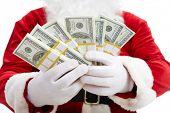 Close-up of Santa?s hands with stacks of dollar banknotes
