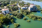 Entire Neighborhood Flooded And Under Water , Straight Down Aerial Drone Angle Above Flooded Mansion poster
