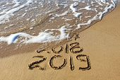 2019, 2018 And 2017 Years Written On Sandy Beach Sea. Wave Washes Away 2017, 2018. poster