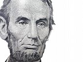 stock photo of abraham lincoln memorial  - Portrait of Abraham Lincoln from the American Five dollar bill over a white background - JPG
