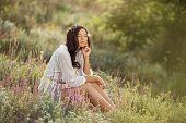 Enjoyment - Free Happy Woman Enjoying Sunset. Beautiful Woman In White Dress Embracing The Golden Su poster