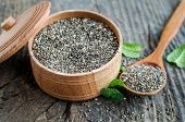 Healthy Chia Seeds In A Wooden Bowl On Old Rustic Wooden Table With A Spoon. Fitness Dietary Super F poster