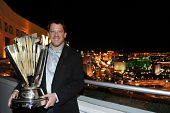 LAS VEGAS, NV - NOV 30: Tony Stewart displays the Nascar Sprint Cup Champion trophy at the Mandalay Bay for the Nascar Sprint Cup Series Champion's Week in Las Vegas, NV on Nov 30, 2011