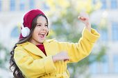 Positive Influence Of Music. Child Girl French Style Outfit Enjoying Music. Childhood And Teenage Mu poster